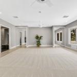 Master Suite With Wet Bar Behind Mirrored Door