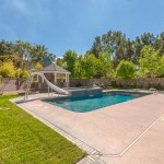 Refreshing Pool With Slide and Diving Board