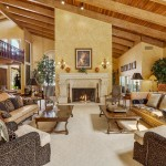 Luxurious Family Room With Vaulted Wood Ceiling & Beautiful Fireplace