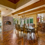 Dining Area With Fireplace & Custom Bar