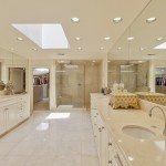 Master Bathroom Includes Marble Counters & Flooring, His and Her Toilets, Jetted Tub, Separate Shower, 2 Sinks, Skylight and Washer & Dryer